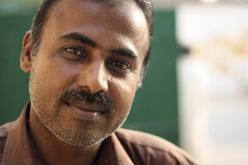 Close-up of an Indian man.
